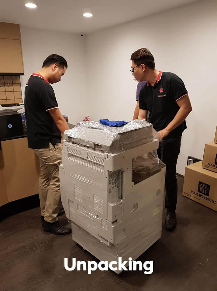 Unpacking Photocopier During Installation