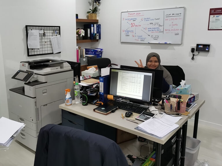 Customer in the office looking happy with the copier machine rented from The Copier Guy in Shah Alam