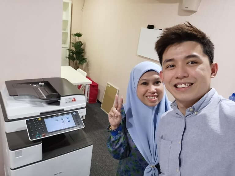 Happpy Customer In Shah Alam Posing Beside a Ricoh Photocopier